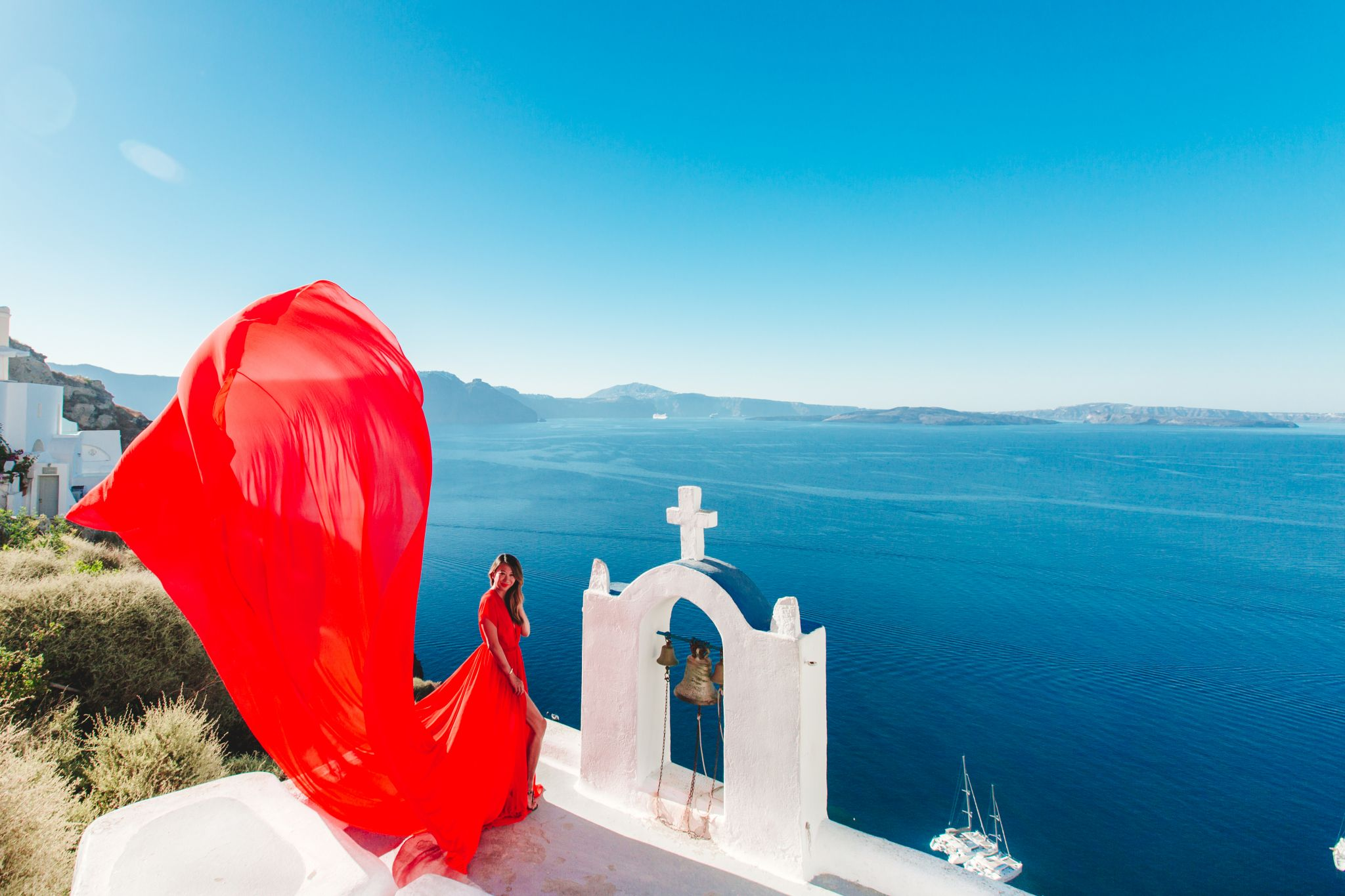 Flying Dress photos Santorini, Best places to take photos in Santorini, Red Dress Photos Greece, Jennifer Worman, Travel Blogger, Chicago Travel Blogger, Best Photos in Santorini