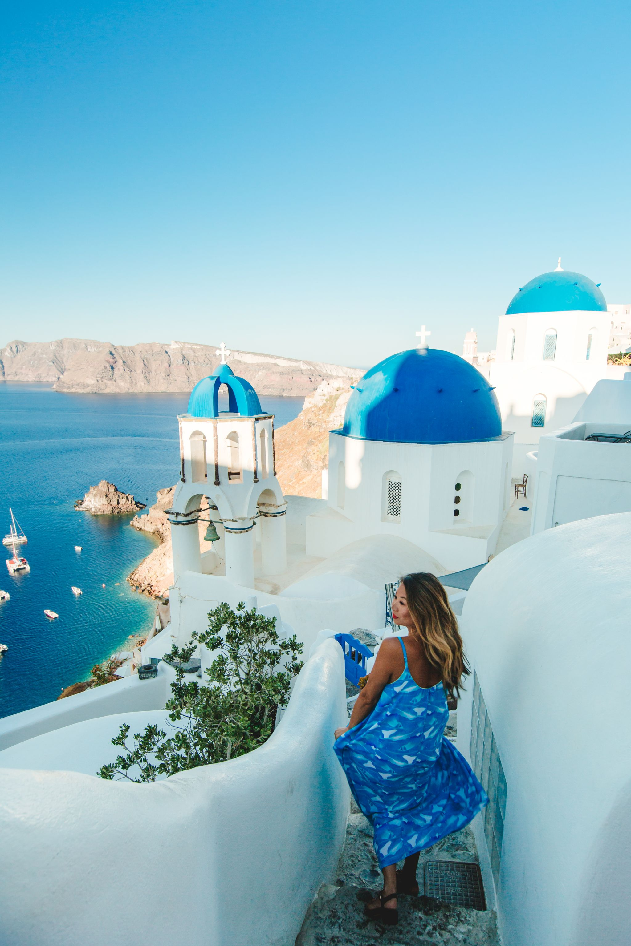 Blue domes santorini, Best places to take photos in Santorini, Best Santorini Photographer, Red Dress Greece Photos, Jennifer Worman, Epic Greece Photos, Where to go in Santorini, Chicago Travel Blogger, Greece Travel, Red Dress Boutique Blue Maxi Dress
