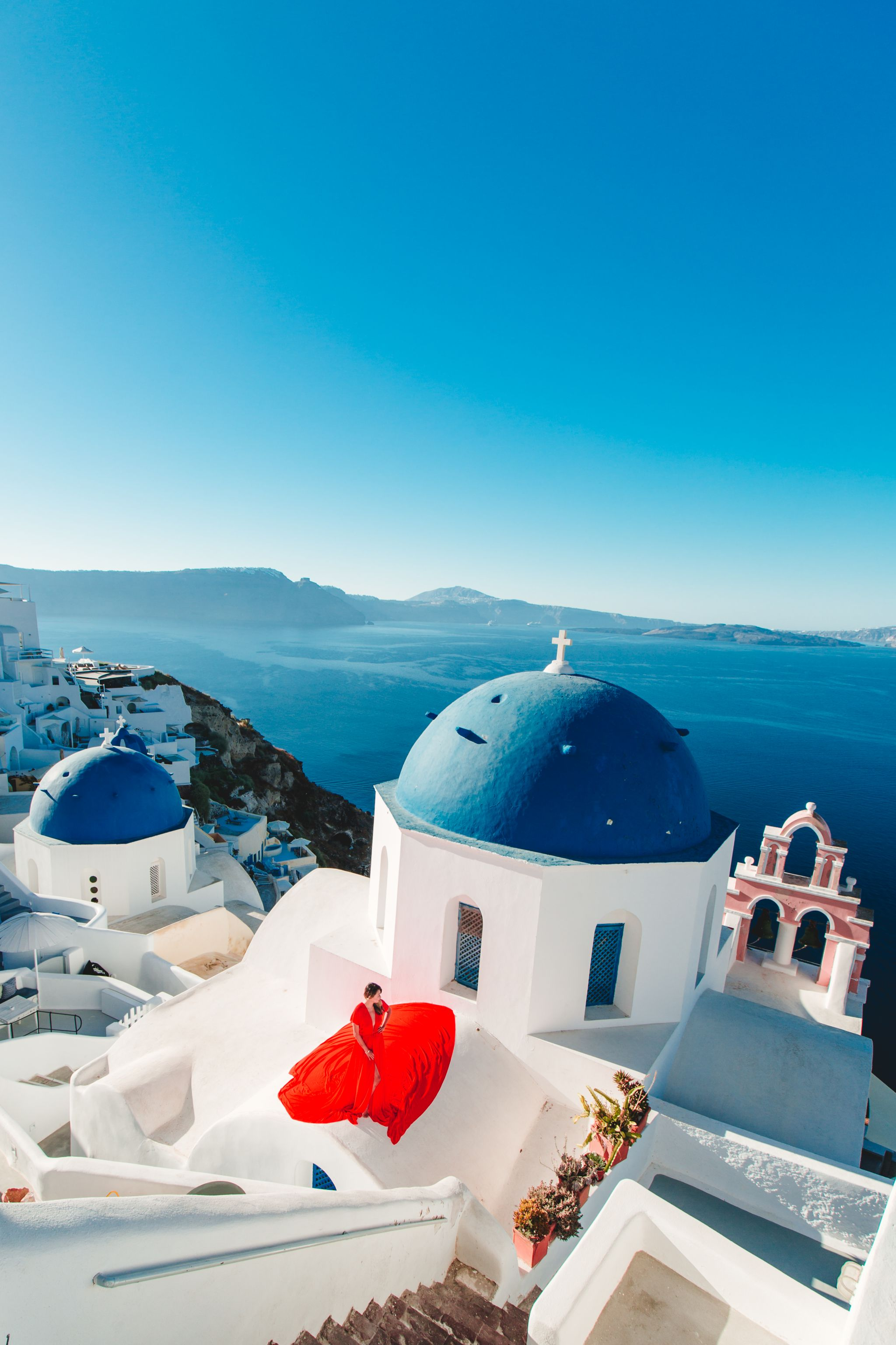 Blue domes santorini, Best places to take photos in Santorini, Best Santorini Photographer, Red Dress Greece Photos, Jennifer Worman, Epic Greece Photos, Where to go in Santorini, Chicago Travel Blogger, Greece Travel
