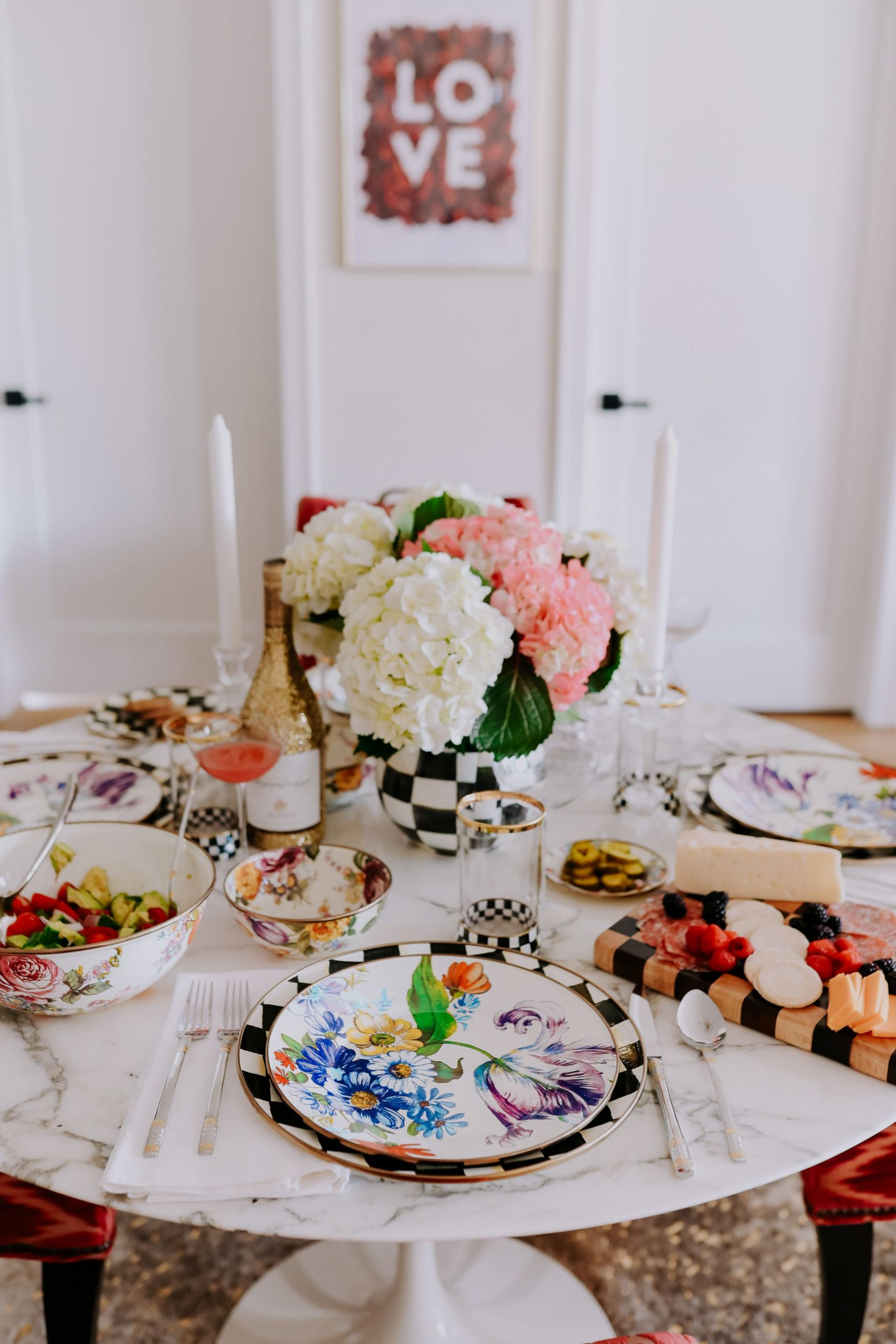 How to set a table MacKenzie Childs, Courtly Check MacKenzie Childs, how to decorate with Mackenzie-Childs, Jennifer Worman Chicago Lifestyle blogger, Mackenzie-childs, Beautiful Handcrafted Ceramics, Dinnerware, Home Decor, black and white dinnerware, black and white check, courtly check, Mackenzie-childs courtly check, kitchen inspiration, dining inspiration, home inspiration, glam home inspiration, classic home inspiration, classic tablecape, check table ideas, checkered table decor, Mackenzie-childs place setting, floral plates, floral tablescape