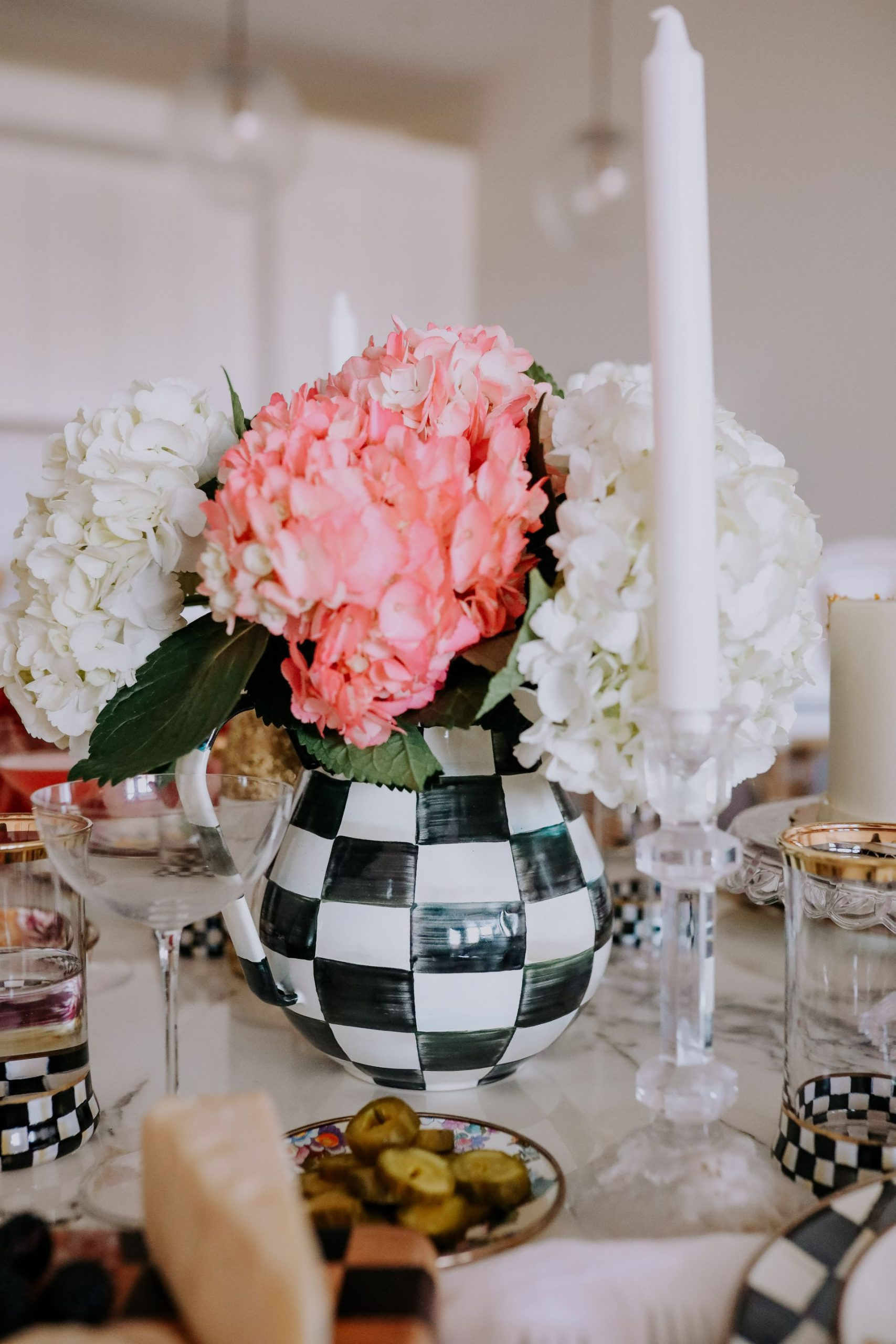 How to set a table MacKenzie Childs, Courtly Check MacKenzie Childs, how to decorate with Mackenzie-Childs, Jennifer Worman Chicago Lifestyle blogger, Mackenzie-childs, Beautiful Handcrafted Ceramics, Dinnerware, Home Decor, black and white dinnerware, black and white check, courtly check, Mackenzie-childs courtly check, kitchen inspiration, dining inspiration, home inspiration, glam home inspiration, classic home inspiration, classic tablecape, check table ideas, checkered table decor, Mackenzie-childs place setting, Mackenzie-childs water pitcher