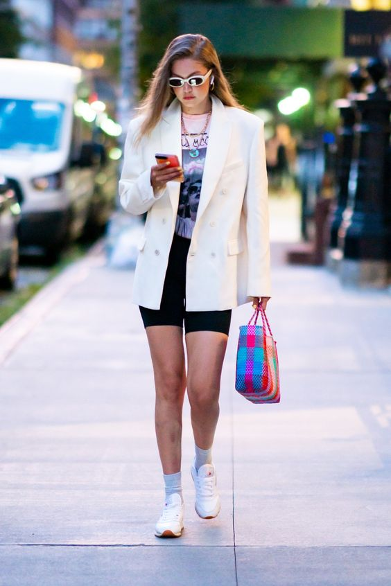 gigi hadid biker shorts outfit, Ways to Wear Biker Shorts Like Celebrities, biker shorts outfit ideas, cycling shorts outfit, how to Wear Biker Shorts Like a celebrity, biker shorts, how to style biker shorts, black biker shorts, street style, street style biker shorts, street style outfits, outfit ideas, womens outfit ideas, celeb style, celebrity style inspiration, biker shorts celebrity style, style inspiration, Jennifer Worman, Red Soles and Red Wine, Gigi Hadid,