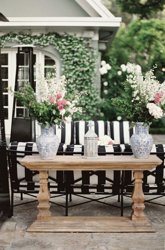 Black and White Outdoor Patios, Black and White Patio inspiration, black and white outdoor style, black and white patio ideas, black and white outdoor furniture, black and white outdoor style, black and white home inspiration, patio style, patio furniture, black and white striped patio, patio furniture ideas, outdoor furniture ideas, outdoor patio style inspiration, home style, interior design, interior, striped black and white outdoor furniture, pretty outdoor spaces, small patio decor ideas, small outdoor space ideas, Red Soles and Red Wine, Jennifer Worman