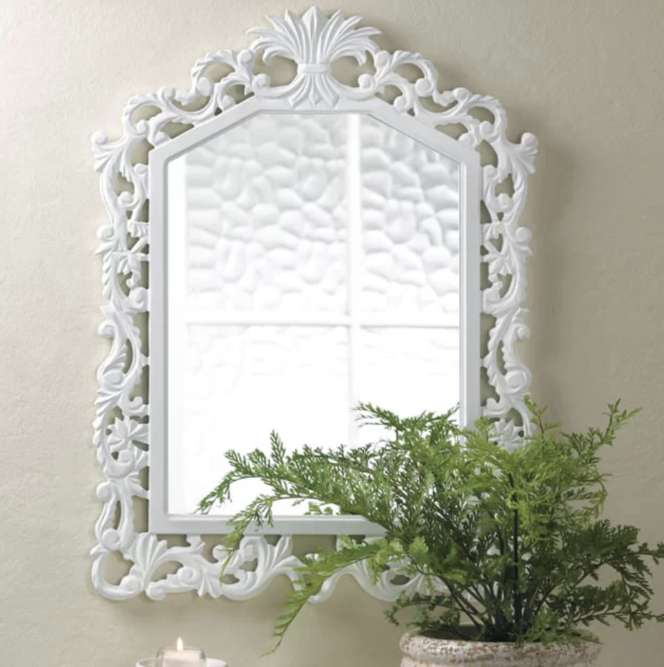 Ornate accent wall hanging mirror