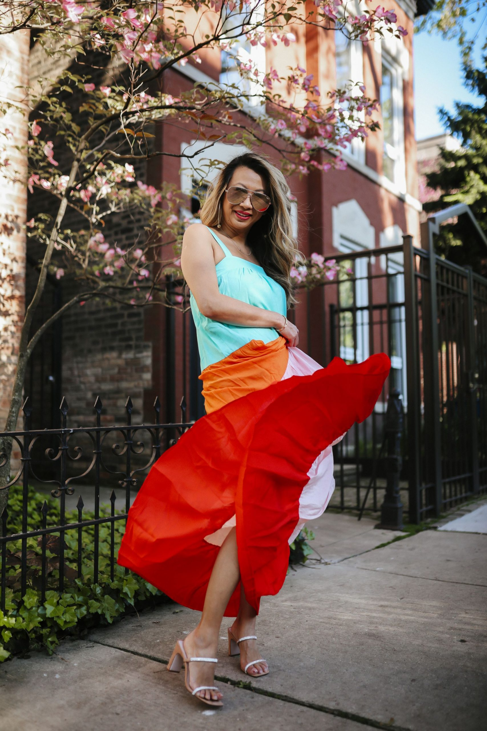 Easy summer dresses under $100, fun dresses for Summer, colorful summer dresses, colorful dress outfit ideas, how to style a colorful maxi dress for Summer, red dress tiered dress