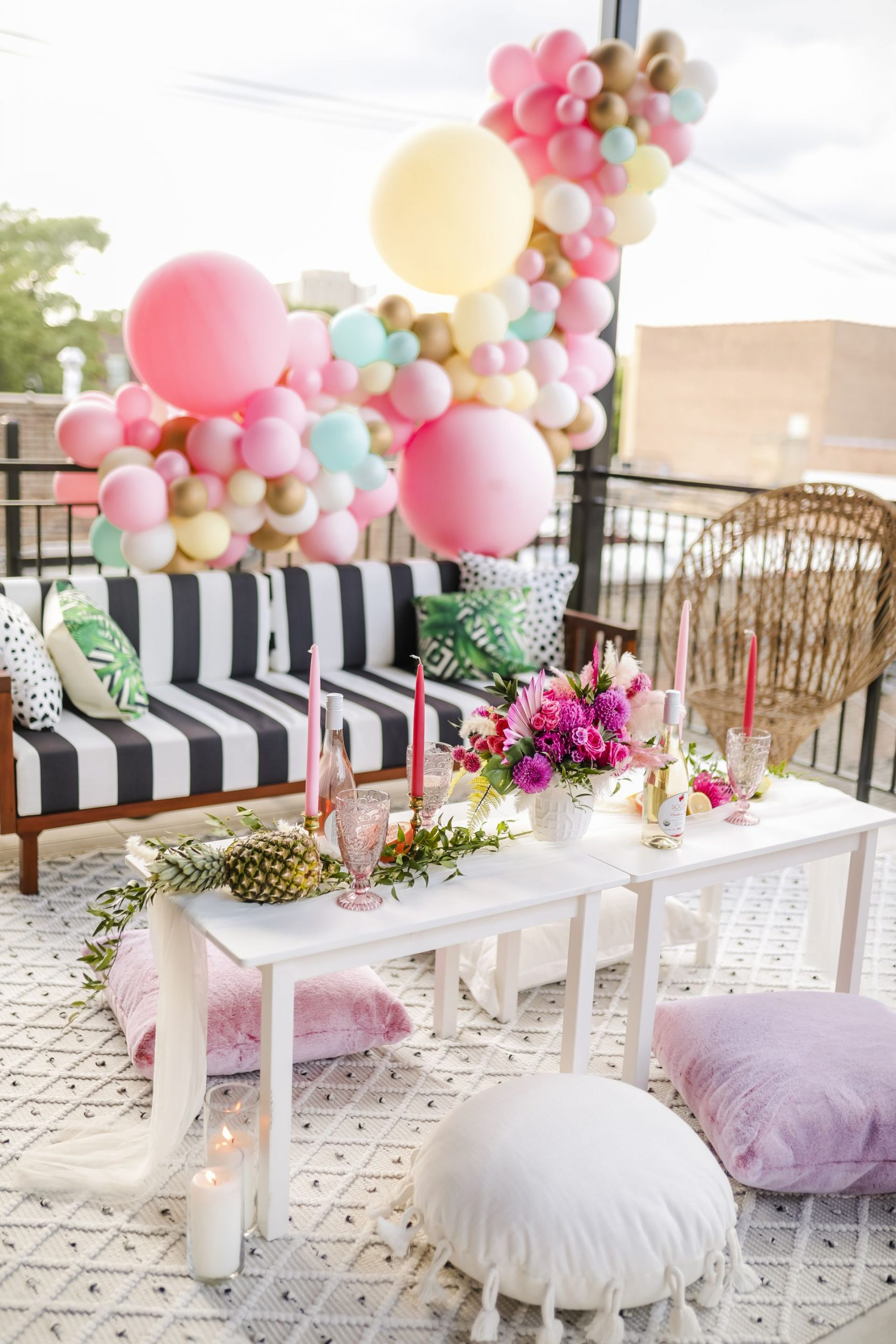 glam patio insp, glam patio party, instagrammable parties, best patio party inspiration, jennifer worman home, stripe couch patio, best patio decor, best patio design, balloon arch, pink party inspiration, pastel balloon arch