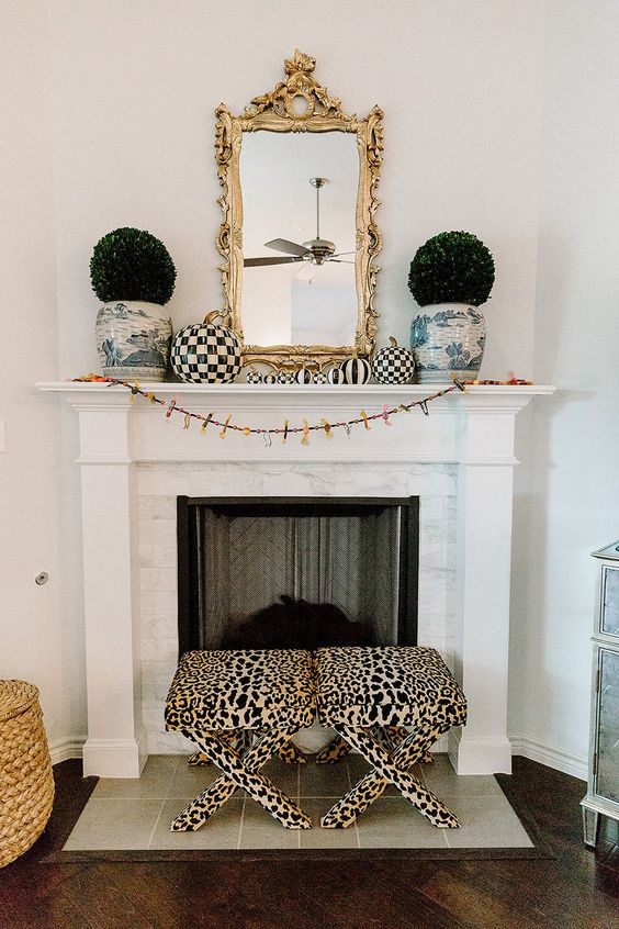 glam fall mantle decor, glam fall decor, glam fall indoor decor ideas, glam decor ideas, fall decor ideas, indoor fall decor, must have glam decor for fall, glam fall interior designs, black and white fall decor, black white gold and pink fall decor, nontraditional fall decor, nonbasic fall decor, pink fall decor, pretty fall decor, Mackenzie-Childs pumpkins, Mackenzie-Childs fall decor ideas, Red Soles and Red Wine, Jennifer Worman