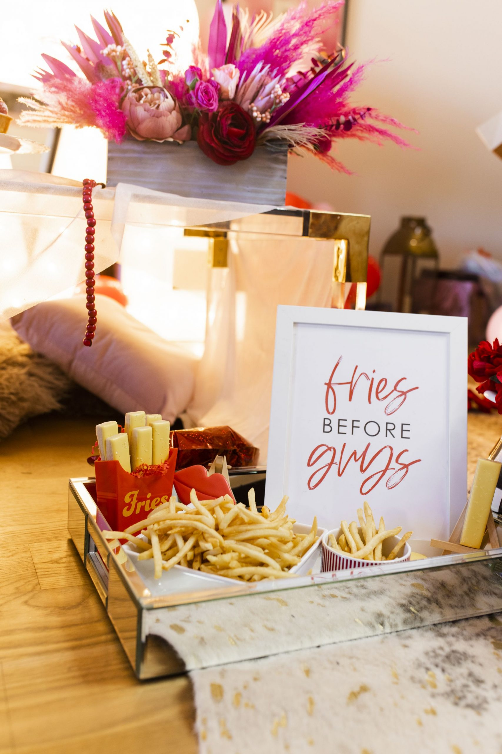 girls night party ideas, fries before guys party set up, girls night in ideas, girls night in party, valentine's day table setting, galentine's table setting, girls night table setting, hearts table settings, girly party theme decor, love party theme decor, valentines day party ideas, valentines day party ideas for adults, Red Soles and Red Wine