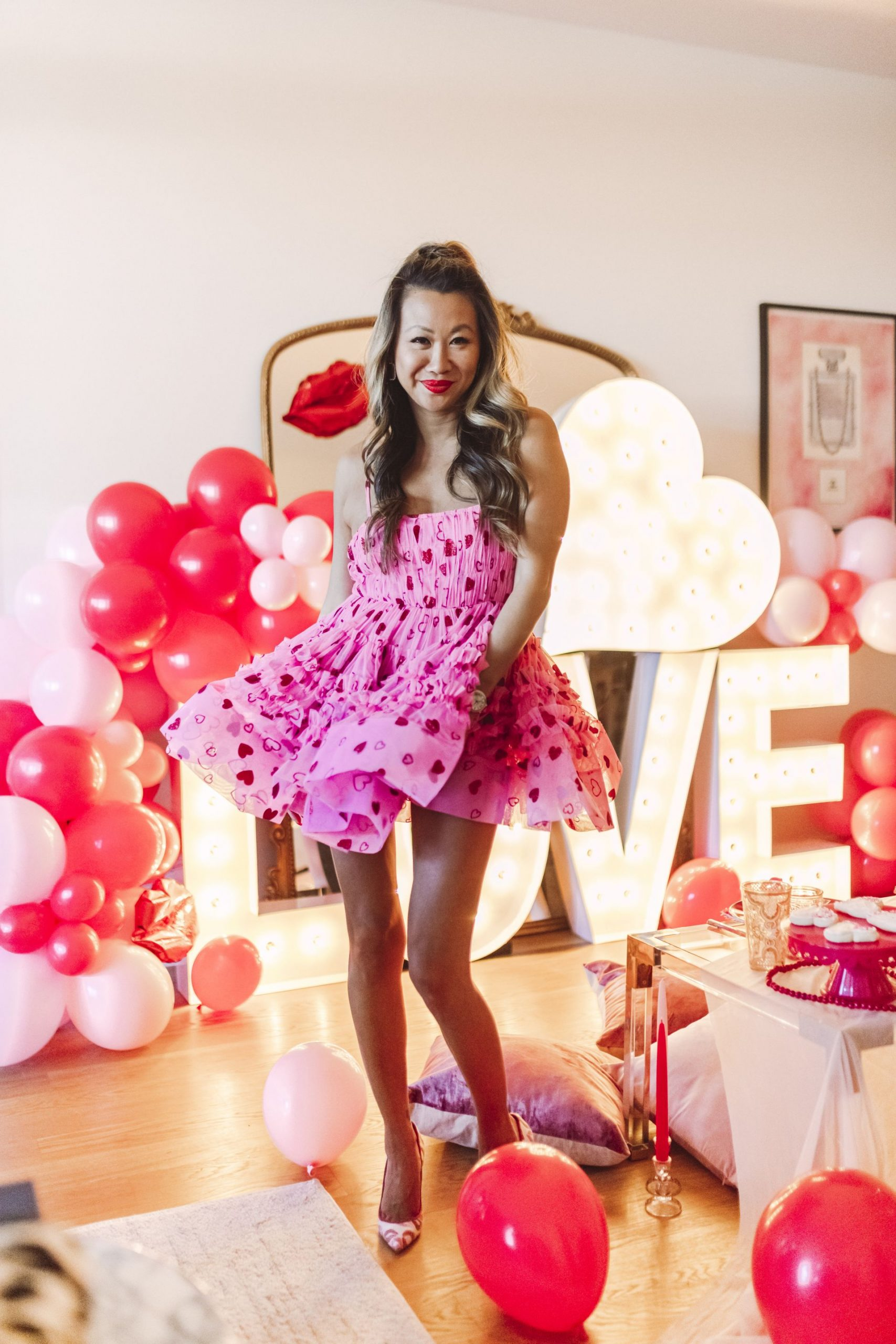 Valentine's Day style, pink vday dress, valentines day dress, galentines day dress, Glam Party Decor Ideas, Galentine's party decor, Valentine's day party decor, girls night party decor ideas, Vday party decorations, pink and red party theme, girly party theme decor, love party theme decor, valentines day party ideas, valentines day party ideas for adults,  light up marquee letters for parties, Red Soles and Red Wine, Jennifer Worman