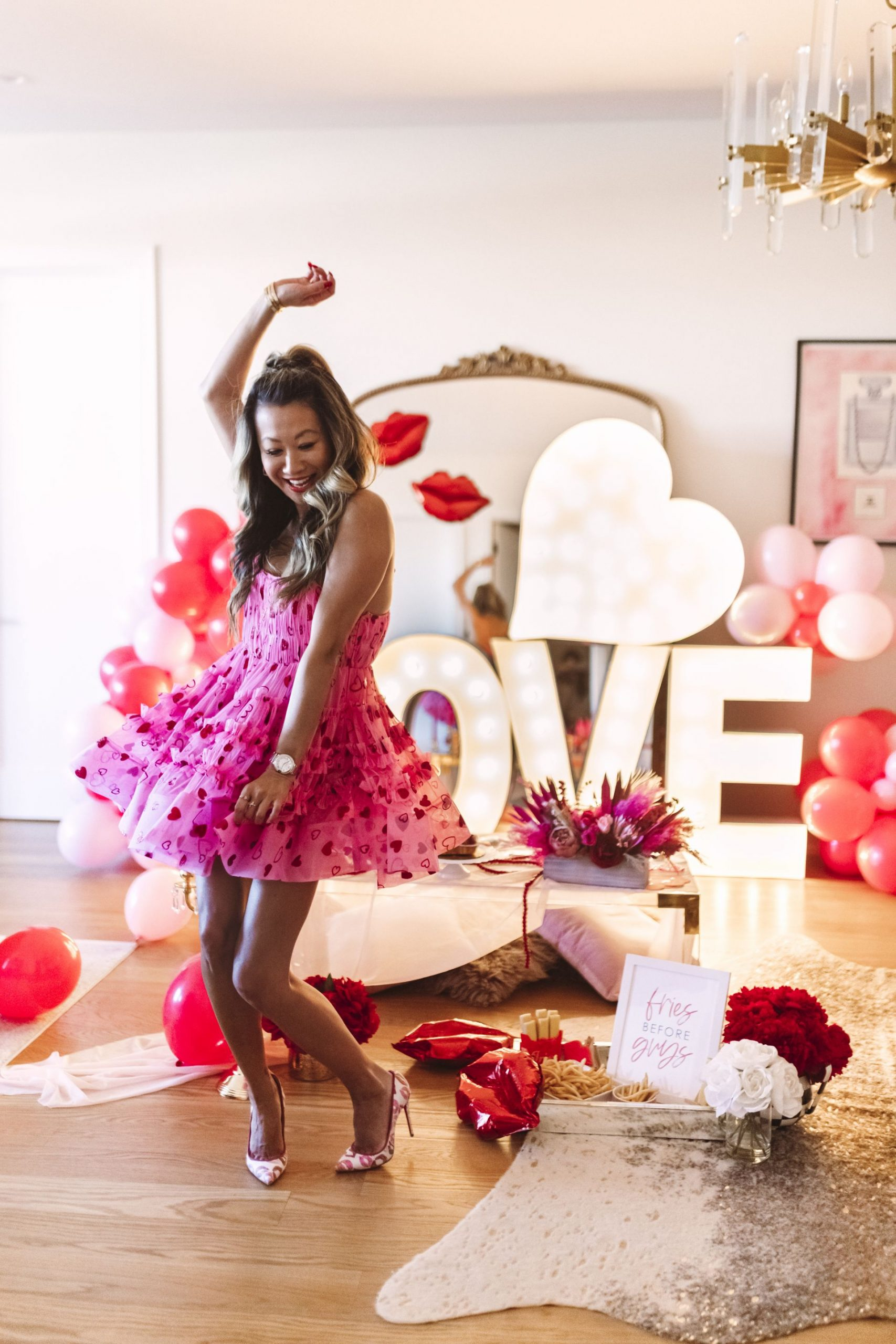 glam Valentine's and Galentine's party, Valentine's Day style, pink vday dress, valentines day dress, galentines day dress, Glam Party Decor Ideas, Galentine's party decor, Valentine's day party decor, girls night party decor ideas, Vday party decorations, pink and red party theme, girly party theme decor, love party theme decor, valentines day party ideas, valentines day party ideas for adults,  light up marquee letters for parties, Red Soles and Red Wine, Jennifer Worman, AlphaLit Chicago Marquee Lights