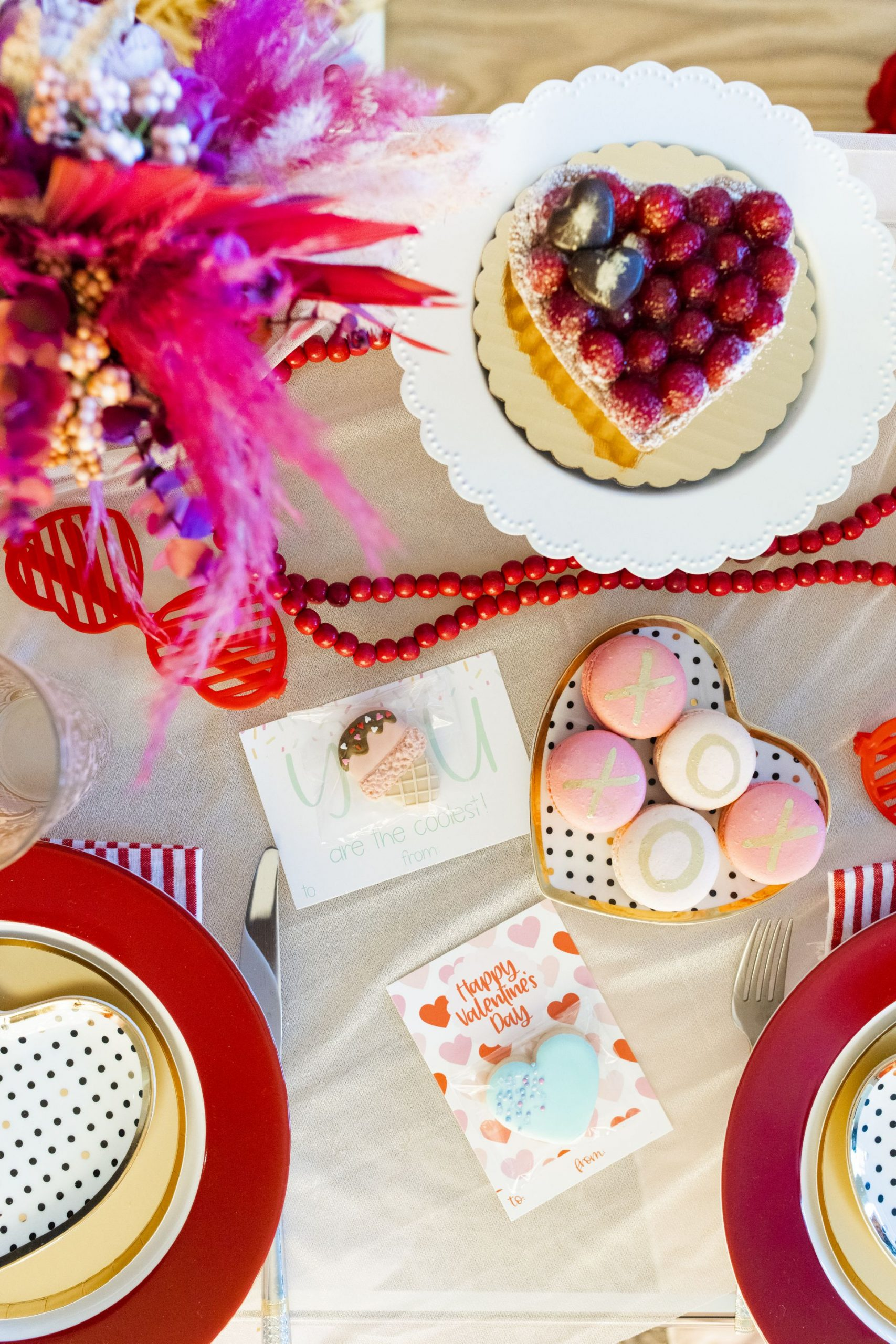 glam Valentine's and Galentine's party, heart place setting, conversation hearts table setting, red and pink table setting, valentine's day table setting, galentine's table setting, red and pink party, intimate table setting ideas, girls night table setting, hearts table settings, sweets table decor ideas, pink and red party theme, girly party theme decor, love party theme decor, valentines day party ideas, valentines day party ideas for adults, Red Soles and Red Wine