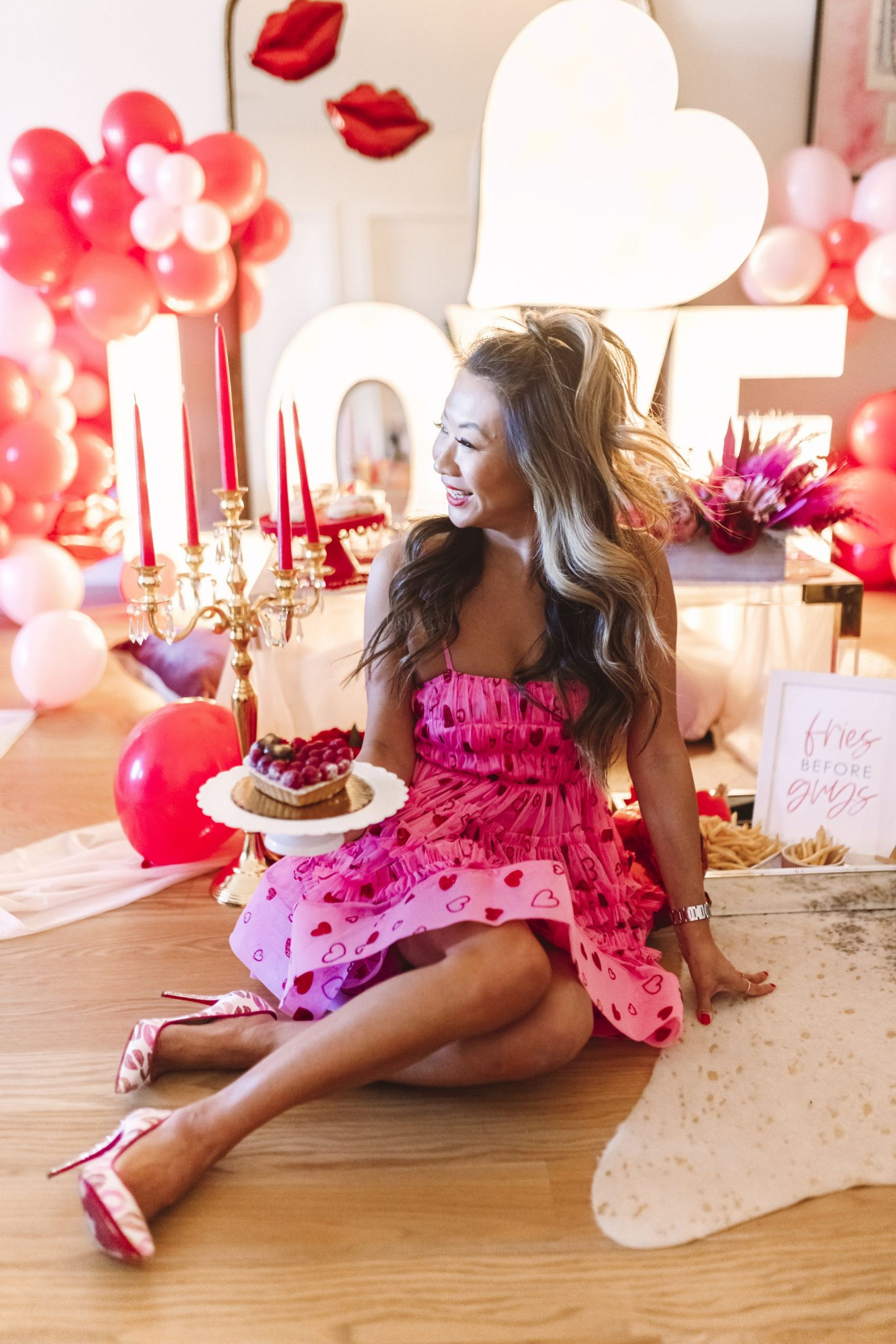Valentine's Day style, pink vday dress, valentines day dress, galentines day dress, Glam Party Decor Ideas, Galentine's party decor, Valentine's day party decor, girls night party decor ideas, Vday party decorations, pink and red party theme, girly party theme decor, love party theme decor, valentines day party ideas, valentines day party ideas for adults,  light up marquee letters for parties, Red Soles and Red Wine, Jennifer Worman, AlphaLit Chicago