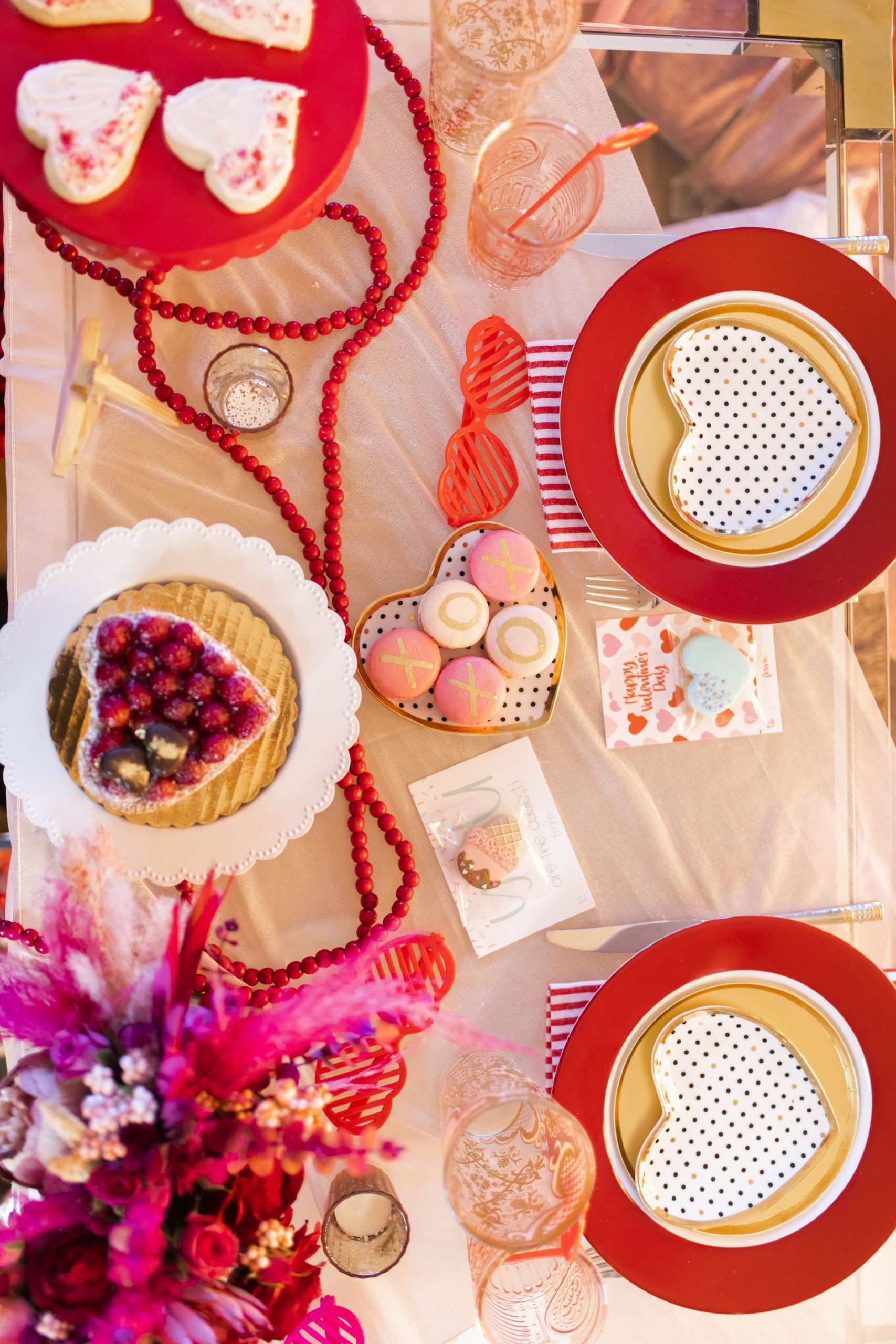 red and pink table setting, valentine's day table setting, galentine's table setting, red and pink party, intimate table setting ideas, girls night table setting, hearts table settings, sweets table decor ideas, pink and red party theme, girly party theme decor, love party theme decor, valentines day party ideas, valentines day party ideas for adults, Red Soles and Red Wine, best desserts in Chicago