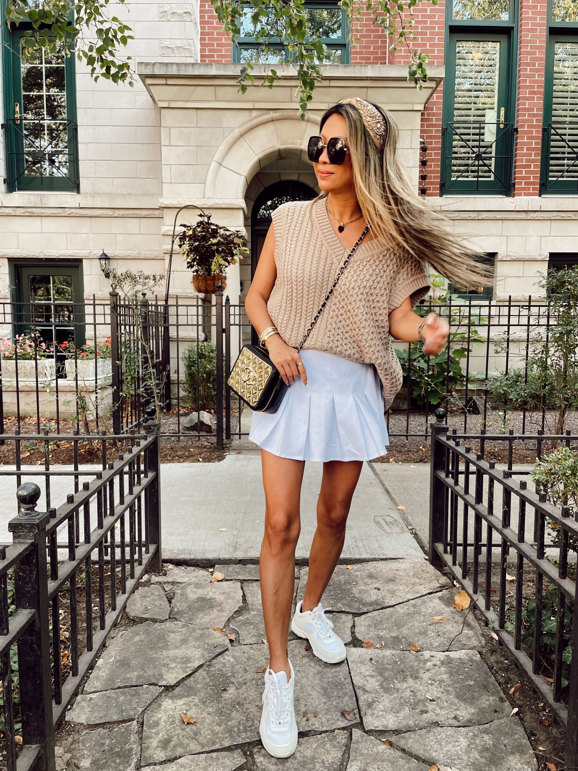 Sweater vest and skort outfit, how to style a sweater vest, sweater vest inspiration, sweater vest outfit, sweater vest ideas, sweater vest outfit ideas, street style sweater vest outfit, neutral sweater vest, outfitideas, fall outfit ideas, fall 2021 outfits, fall 2021 trends, fashion blogger, style blogger, fashion photography, outfitphoto ideas, outfit photography ideas, Red Soles and Red Wine, Jen Worman