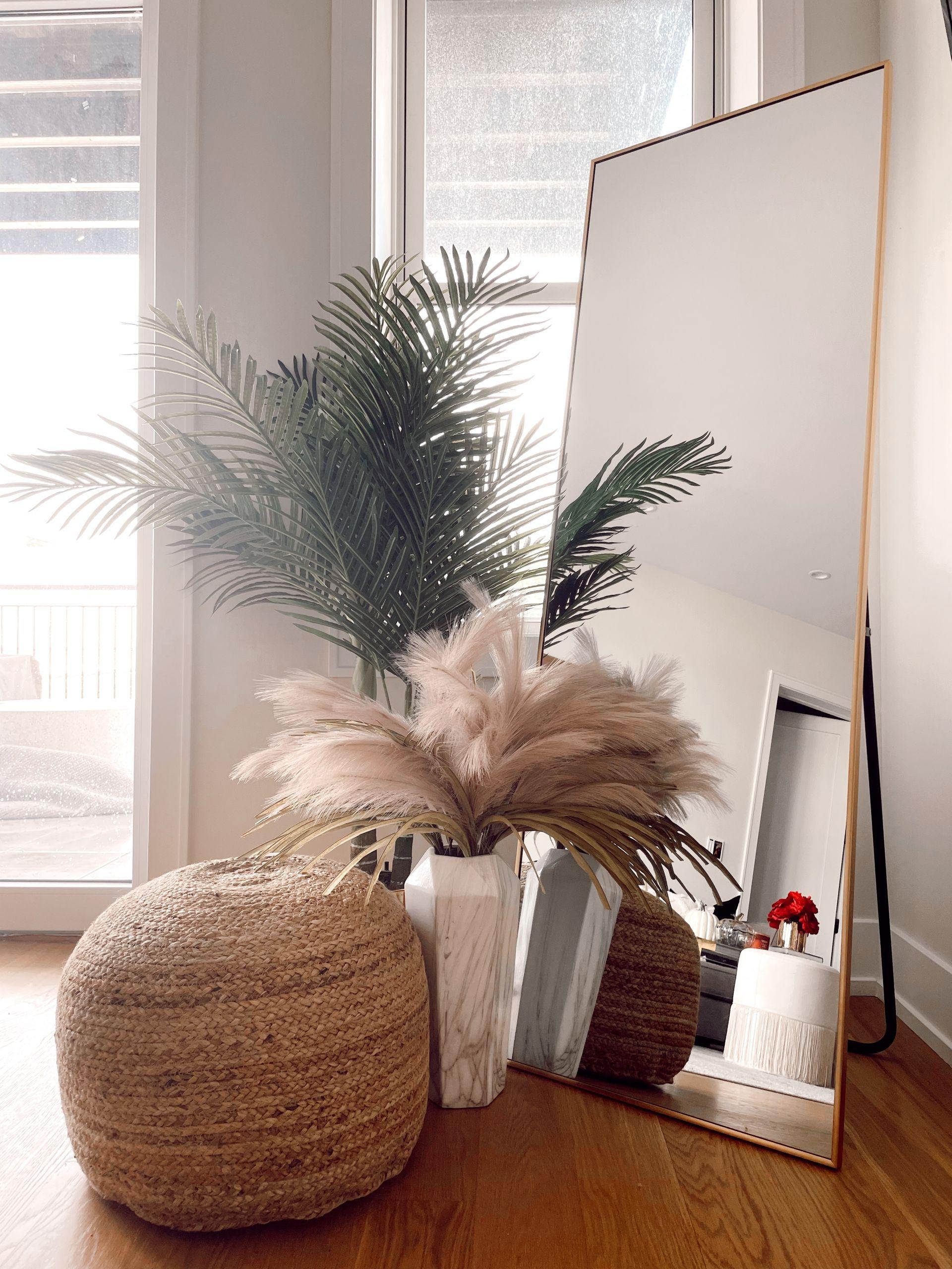 pampas grass inspiration, pampas grass styling, pampas grass living room, pampas grass mirror ideas, gold mirror styling, jute pouf, boho neutral pouf, floor mirror styling ideas